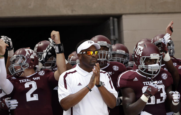 FILE - In this Sept. 8, 2012, file photo, Texas A&M coach Kevin Sumlin, center, prepares to lead his team onto the field for an NCAA college football game against Florida in College Station, Texas. Texas A&M begins a stretch of three straight road games on Saturday when the 22nd-ranked Aggies visit Auburn. They aren't concerned about the tough road stretch. The first-year A&M coach has won his nine straight games away from home dating back to his time at Houston. (AP Photo/David J. Phillip, File)