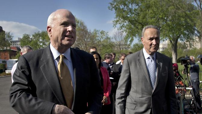 Sen. John McCain, R-Ariz., left, and Sen. Charles Schumer, D-N.Y., talk to the media outside the White House in Washington, Tuesday, April 16, 2013, following a meeting with President Barack Obama to discuss immigration. (AP Photo/Manuel Balce Ceneta)