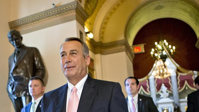 Speaker of the House John Boehner, R-Ohio, smiles as he walks to the floor of the House of Representatives as the GOP majority passed legislation to replace the No Child Left Behind law, in Washington, Friday, July 19, 2013. The Student Success Act reflects the long-held Republican premise that Washington has no business determining how local school systems are run. (AP Photo/J. Scott Applewhite)