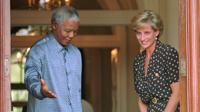 FILE - In this March 17, 1997 file photo, South African President Nelson Mandela, left, shows the way to Britain's Princess Diana in Cape Town, South Africa, where they discussed the threat of AIDS in the country. South Africa's president Jacob Zuma says, Thursday, Dec. 5, 2013, that Mandela has died. He was 95. (AP Photo/Sasa Kralj, File)