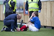Rangers' David Templeton is treated on the pitch before being stetchered off injured at Annan