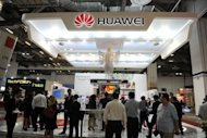 Visitors gather at the Huawei both during the CommunicAsia telecom expo and conference in Singapore in June 2012. The fear in the United States and other countries is that Huawei, the second largest provider of carrier network infrastructure in the world, will allow its platforms to be manipulated by the Chinese government