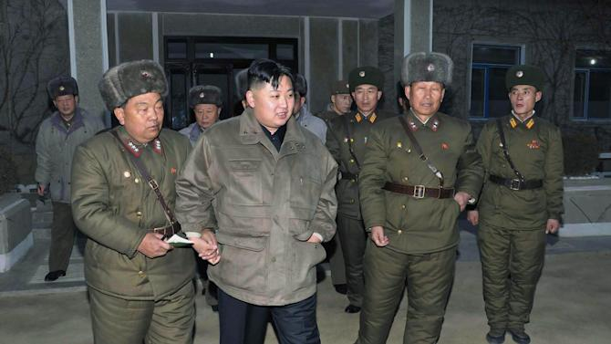 FILE - In this undated file photo released by the Korean Central News Agency and distributed in Tokyo by the Korea News Service on Thursday, Jan. 19, 2012, North Korean leader Kim Jong Un, second from left, walks during his visit to a military unit at an undisclosed location in North Korea. For the outside world, North Korea's message is largely doom and gloom: bombastic threats of nuclear war, amateur-looking videos showing U.S. cities in flames, digitally altered photos of military drills. But a domestic audience gets a parallel and decidedly softer dose of propaganda - and one with potentially higher stakes for the country's young leader. (AP Photo/KCNA via KNS, File)