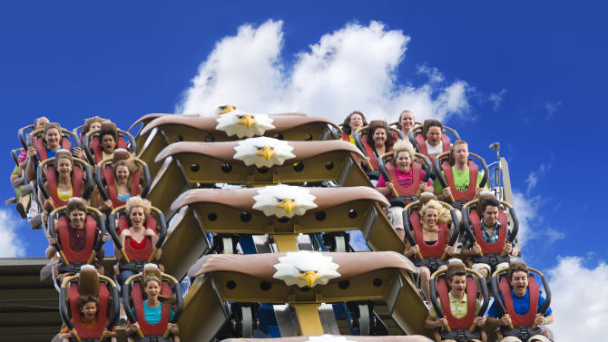 This undated photo provided by Dollywood shows riders on the Wild Eagle, a new 210-foot tall coaster that opened in March at the theme park in Pigeon Forge, Tenn.  The coaster is one of a number of new attractions opening at theme parks around the country this season. (AP Photo/Dollywood, Steven Bridges)