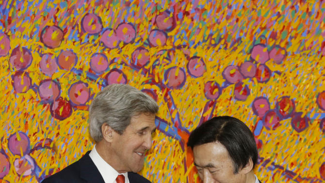 U.S. Secretary of State John Kerry, left, and South Korean Foreign Minister Yun Byung-se chat as they pose for photos before their meeting at the foreign ministry in Seoul, Friday, April 12, 2013. Kerry arrived in South Korea on Friday on an unusual diplomatic journey, traveling directly into a region bracing for a possible North Korean missile test and risking that his presence alone could spur Pyongyang into another headline-seeking provocation. (AP Photo/Lee Jae-won, Pool)