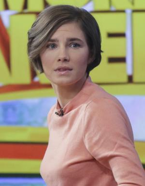 """Amanda Knox prepares to leave the set following a television interview, Friday, Jan. 31, 2014 in New York. Knox said she will fight the reinstated guilty verdict against her and an ex-boyfriend in the 2007 slaying of a British roommate in Italy and vowed to """"never go willingly"""" to face her fate in that country's judicial system . """"I'm going to fight this to the very end,"""" she said in an interview with Robin Roberts on ABC's """"Good Morning America."""" (AP Photo/Mark Lennihan)"""