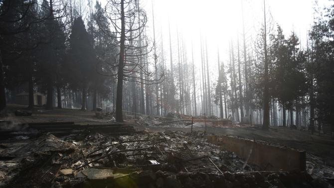 The remains of a structure burned by the King Fire is seen in White Meadows, northeast of Sacramento, California