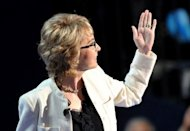 Former congresswoman Gabrielle Giffords waves to the audience at the Democratic National Convention after leading the crowd in the Pledge of Alligence