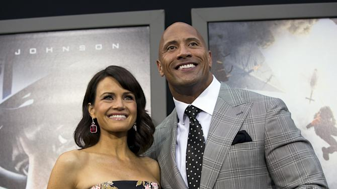 "Cast members Johnson and Gugino pose at the premiere of ""San Andreas"" in Hollywood"