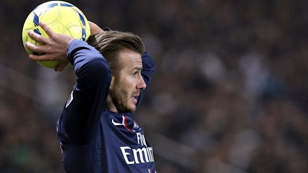 Paris St-Germain's David Beckham throws the ball during the Ligue 1 soccer match against Montpellier at the Parc des Princes Stadium in Paris March 29, 2013. (Reuters)
