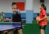 A student is seen being advised by her table tennis coach as she trains at the Shichahai Sports School in Beijing, in August. China's status as a sporting superpower was achieved on the back of intense state-led training in schools, but the current crop of coaches and students say there is life outside the sports halls