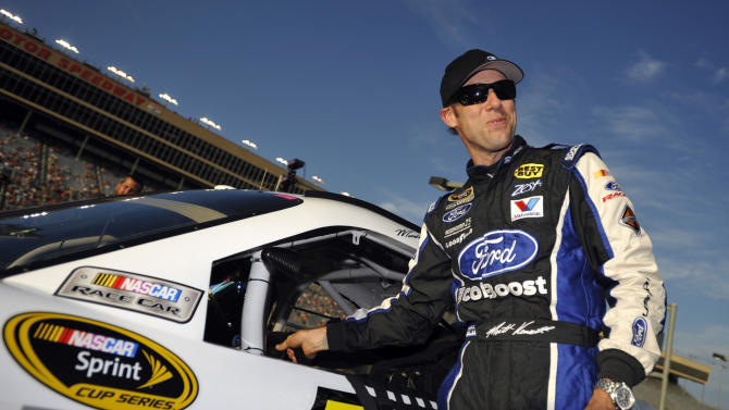 Matt Kenseth smiles after getting out of his car during qualifying for Sunday's NASCAR Sprint Cup Series auto race at Atlanta Motor Speedway, Friday, Aug. 31, 2012, in Hampton, Ga. (AP Photo/Rainier Ehrhardt)