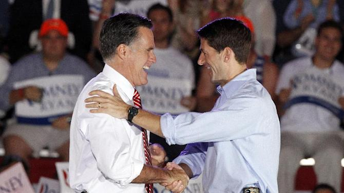 Republican presidential candidate former Massachusetts Gov. Mitt Romney and his running mate Rep. Paul Ryan, R-Wis., embrace during a rally in Fishersville, Va., Thursday, Oct. 4, 2012. (AP Photo/Steve Helber)