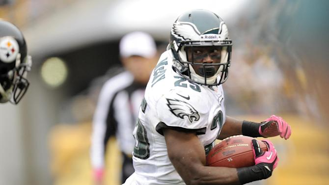 Philadelphia Eagles running back LeSean McCoy (25) runs past Pittsburgh Steelers inside linebacker Lawrence Timmons (94) in the first quarter of an NFL football game on Sunday, Oct. 7, 2012, in Pittsburgh. (AP Photo/Don Wright)