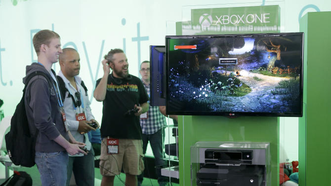 A group of men play XBox One games at the Game Developers Conference 2014 in San Francisco, Tuesday, March 18, 2014. The conference will run from March 17-21 at San Francisco's Moscone Center. (AP Photo/Jeff Chiu)