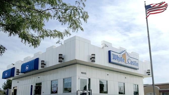 "FILE - This June 21, 2004 file photo shows a White Castle restaurant in Columbus, Ohio. White Castle, the 90-year-old hamburger chain known for its square ""slider"" burgers, is considering the idea of offering alcoholic beverages. (AP Photo/Jay LaPrete, File)"
