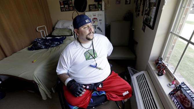 In a Thursday, June 19, 2014 photo, Brent Kaderli, a 30-year-old quadriplegic, sits in his room at the Baywood Crossing Rehabilitation and Healthcare Center, in Pasadena, Texas. Kaderli said Medicaid approved him for only three hours of at-home daily care, but he'd need at least six to get by while his father is at work. So he lives in a nursing home in Pasadena, Texas instead of at his father's house with help from aides. (AP Photo/David J. Phillip)