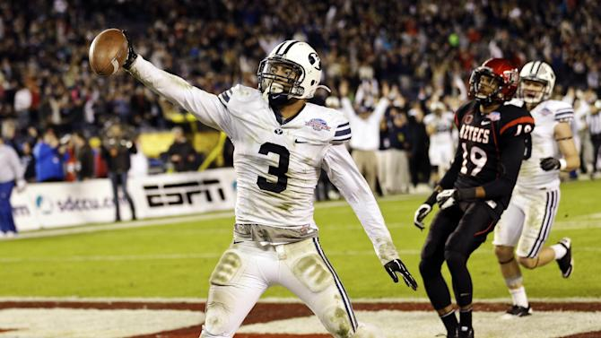 BYU linebacker Kyle Van Noy holds out the ball as he scores on a 17-yard interception return during the fourth quarter of the Poinsettia Bowl NCAA college football game against San Diego State, Thursday, Dec. 20, 2012, in San Diego. BYU defeated San Diego State 23-6.  (AP Photo/Lenny Ignelzi)