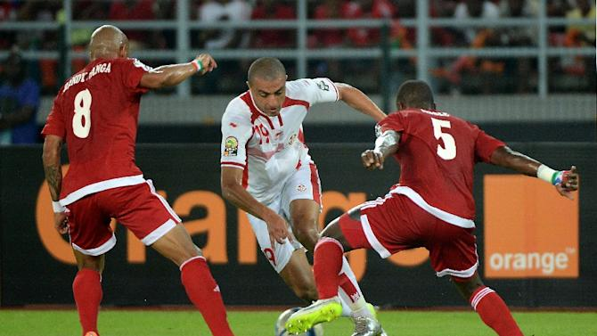 Tunisia's forward Ahmed Akaichi (centre) challenges Equatorial Guinea's defender Diosdado Mbele and Equatorial Guinea's midfielder Randy (left) during their 2015 African Cup of Nations quarter-final match in Bata on January 31, 2015