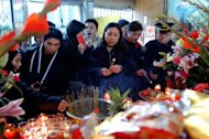 New Yorkers of Asian decent offer prayers to Buddha on the occasion of the lunar New Year in 2004. Asian-American Hindus also boasted a greater percentage of adults with a household income of more than $100,000 -- 48 percent -- than any other religious group in US society