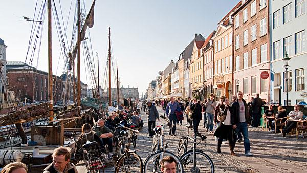 3. Denmark Highest income tax rate: 55.4%  Average 2010 income: $64,000   Denmark's top marginal rate has come down from 62.3 percent in 2008 to 55.4 percent today after the government reached a deal to cut taxes worth $4.8 billion in 2009 to boost the economy. But the country still has the world's third-highest income tax rate.   Denmark's current top tax rate kicks in at $76,000. Dividend income and capital gains are generally taxed between 28 percent and 42 percent, while some share types can be taxed at rates up to 51.5 percent. Members of the Danish church are also liable to a tax of 0.4 percent to 1.5 percent. Other notable taxes include a real estate tax of between 1 percent and 3 percent of a property's value, while gifts to close relatives over a certain threshold are subject to a 15 percent tax.   Denmark has gradually decreased the tax and social security burden on incomes over the last decade, according to the OECD. The tax wedge, which is income tax as a percentage of total labor costs, decreased for all families as a result of tax cuts implemented from 2000 to 2011. Single Danes with average-to-high income have benefited the most from the tax cuts.   Pictured: Copenhagen  Photo: Hendrik Holler | Getty Images