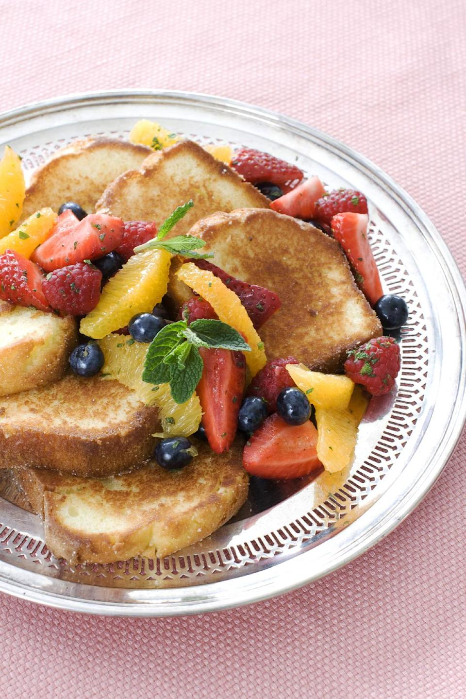 n this image taken on March 11, 2013, pan-seared pound cake with minty fruit salad is shown served on a plate in Concord, N.H. (AP Photo/Matthew Mead)