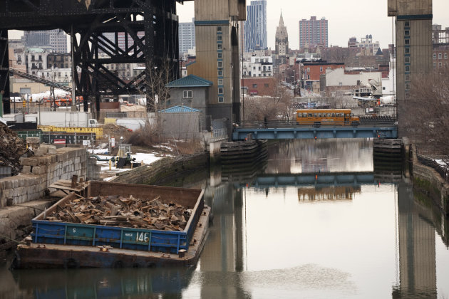 <p>               FILE - This file photo of March 2, 2010 shows the Gowanus Canal, which was added to the Superfund National Priorities List in 2010 for being heavily contaminated with PCBs, heavy metals, volatile organics and coal tar wastes. New York, New Jersey and EPA officials say toxic sites are OK after Superstorm Sandy, but The Associated Press has found that few actual tests have been done. (AP Photo/Mark Lennihan, File)