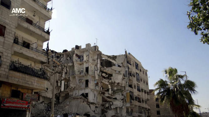 This citizen journalism image provided by Aleppo Media Center AMC which has been authenticated based on its contents and other AP reporting, shows buildings damaged in a government airstrike and shelling at Bostan Pasha district in Aleppo, northern Syria, Friday, April 12, 2013. The airstrikes come a day after a U.S.-based human right group accused the Syrian air force of carrying out indiscriminate attacks on civilian areas around the country — attacks the group claims amount to war crimes.  (AP Photo/Aleppo Media Center AMC)
