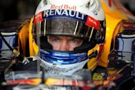 Red Bull Racing's German driver Sebastian Vettel sits in the pits during the third practice session at the Circuit de Monaco in May 2012 in Monte Carlo ahead of the Monaco Formula One Grand Prix. Vettel dismissed the idea that he is poised to join Ferrari, setting up a summer scramble among his rivals to claim the possible spare seat alongside Fernando Alonso