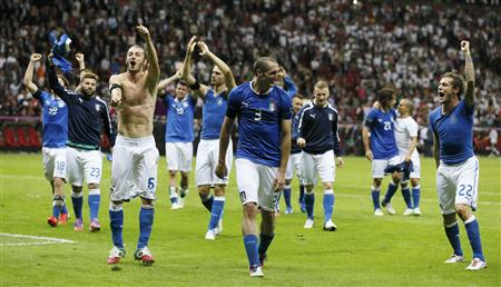 Italy's Montolivo, Nocerino, Balzaretti, Chiellini and Diamanti with the team mates celebrate victory over Germany during their Euro 2012 semi-final soccer match at National Stadium in Warsaw