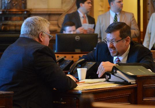 Kansas Senate Majority Leader Terry Bruce, right, R-Nickerson, confers with Sen. Mike Petersen, left, R-Wichita, during a contentious debate on tax issues, Monday, June 1, 2015, at the Statehouse in Topeka, Kan. Republican legislators are sharply divided over proposals for raising taxes to close a budget shortfall. (AP Photo/Nicholas Clayton)