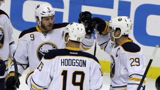 Buffalo Sabres center Steve Ott (9) celebrates his first-period goal with Buffalo Sabres right wing Jason Pominville (29) and center Cody Hodgson (19) during an NHL hockey game against the Pittsburgh Penguins in Pittsburgh Tuesday, April 2, 2013. (AP Photo/Gene J. Puskar)