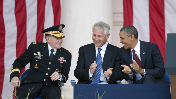President Barack Obama talks with Secretary of Defense Chuck Hagel, center, and Chairman of the Joint Chiefs of Staff Gen. Martin Dempsey, left, as they wait to deliver their Memorial Day remarks at Arlington National Cemetery in Arlington, Va., Monday, May 27, 2013. (AP Photo/Cliff Owen)