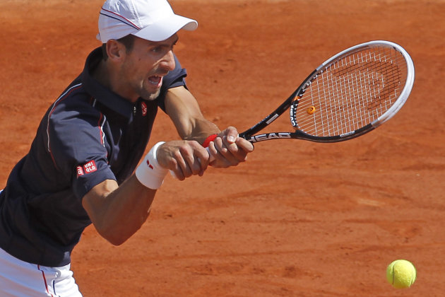 Novak Djokovic of Serbia returns in his second round match against Blaz Kavcic of Slovenia at the French Open tennis tournament in Roland Garros stadium in Paris, Wednesday May 30, 2012. (AP Photo/Michel Euler)