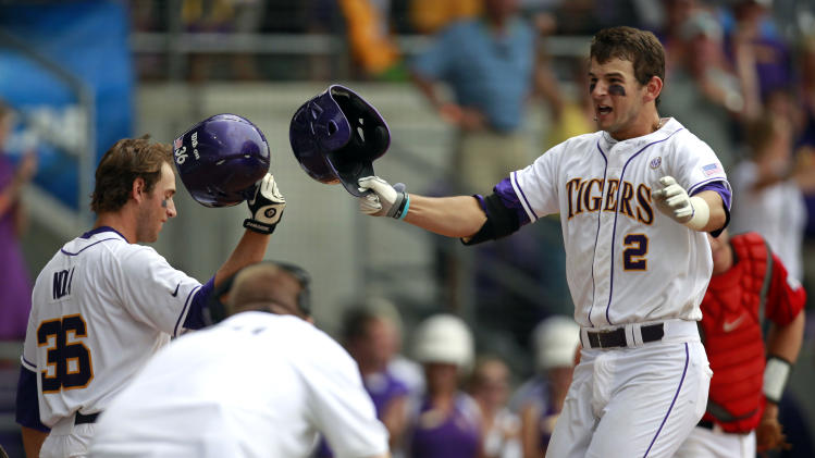 LSU's Tyler Moore (2) celebrates his solo home run with teammate Austin Nola (36) in the tenth inning of an NCAA college baseball tournament super regional game against Stony Brook in Baton Rouge, La., Friday, June 8, 2012. (AP Photo/Gerald Herbert)