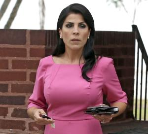 FILE - In this Nov. 13, 2012, file photo, Jill Kelley leaves her home in Tampa, Fla. The way the FBI responded to Jill Kelley's complaint about receiving harassing emails, which ultimately unraveled or scarred the careers of ex-CIA Director David Petraeus and Marine Gen. John Allen, is the exception, not the rule. The FBI commonly declines to pursue cyberstalking cases without compelling evidence of serious or imminent harm to an individual, victims of online harassment, advocacy groups and computer crime experts told The Associated Press. (AP Photo/Chris O'Meara, File)