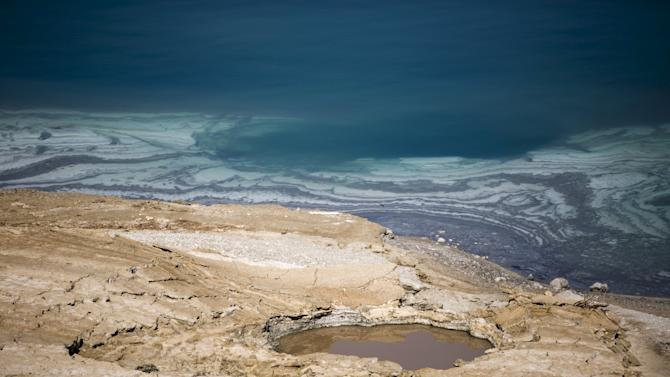 A sinkhole is seen on the shore of the Dead Sea