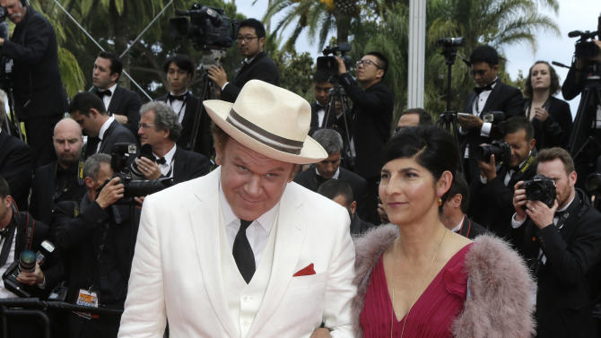 Actor John C. Reilly, left, and his partner Alison Dickey pose for photographers upon arrival for the awards ceremony at the 68th international film festival, Cannes, southern France, Sunday, May 24, 2015. (AP Photo/Lionel Cironneau)