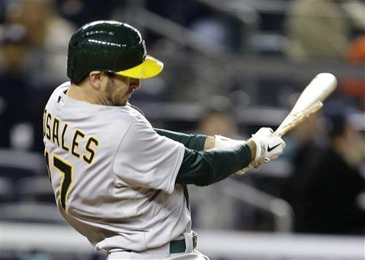 Griffin shuts down Yanks, Rosales homers for A's