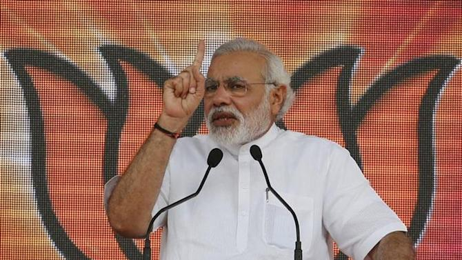 Hindu nationalist Narendra Modi, prime ministerial candidate for the Bharatiya Janata Party (BJP) and Gujarat's chief minister addresses his party supporters during a rally in New Delhi September 29, 2013. REUTERS/Adnan Abidi/Files