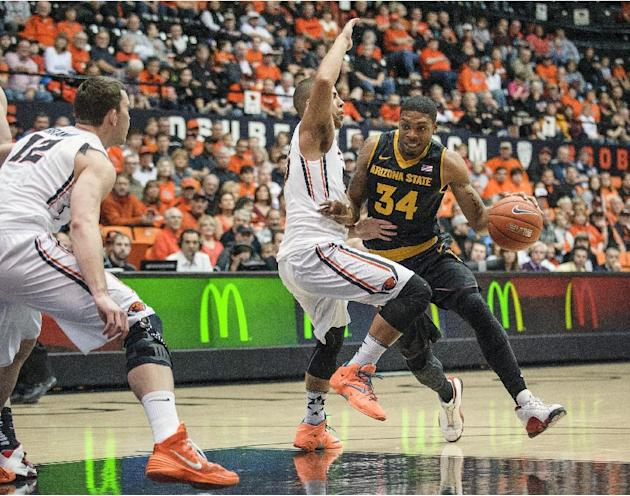 Arizona State's Jermaine Marshall right, drives on Oregon State's Roberto Nelson during the first half of an NCAA college basketball game in Corvallis, Ore., Saturday, March 8, 2014