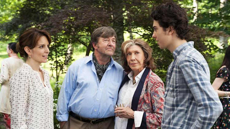 "This publicity photo released by Focus Features shows, from left, Tina Fey, who stars as Portia, Olek Krupa as Professor Polokov, Lily Tomlin stars as Susannah and Nat Wolff as Jeremiah, in a scene from the film, ""Admission,"" directed by Paul Weitz. The movie is a Focus Features release opening March 22. (AP Photo/Focus Features, David Lee)"