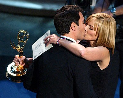 Eric McCormack is kissed by Kim Cattrall