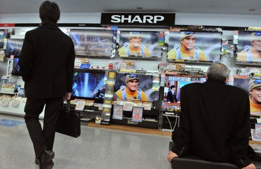 <p>File photo of Sharp televisions on sale in an electrical shop in Tokyo. Sharp Corp. shares tumbled in early Tokyo trade on Thursday after a report that the struggling consumer electronics giant lost 400 billion yen ($5.0 billion) in the first six months of its fiscal year.</p>