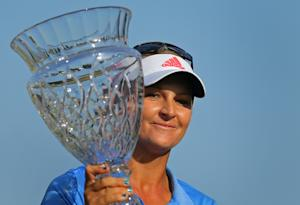 Anna Nordqvist, of Sweden, holds the trophy after winning…
