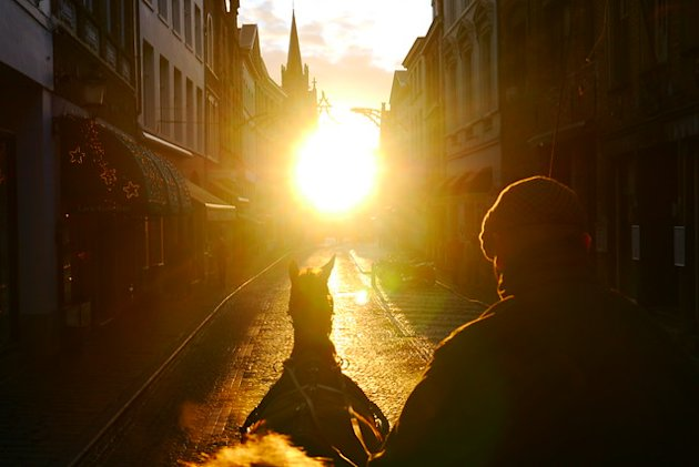 Riding at Dawn in Bruges
