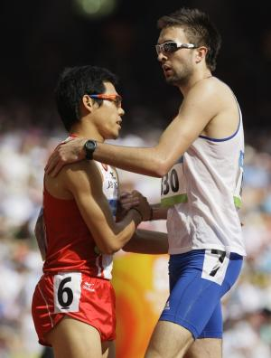 FILE - In this Aug. 18, 2008, file photo, Japan's Yuzo Kanemaru, left, and Britain's Martyn Rooney shake hands after a heat of the men's 400 meters during the athletics competition in the National Stadium at the Olympics in Beijing. The British team has been advised by its top doctor to avoid shaking hands with rivals and visiting dignitaries at the London Games this summer. The reason: Olympic germs could cost Olympic gold. (AP Photo/Anja Niedringhaus, File)