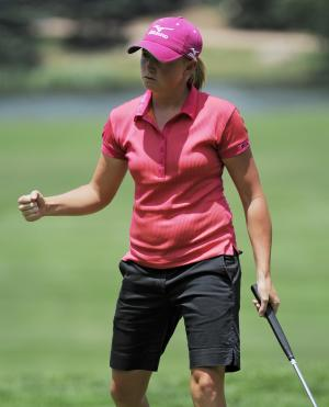 Stacy Lewis pumps her first after making a birdie on the sixth hole during the weather delayed first round of the Women's U.S. Open golf tournament at the Broadmoor Golf Club on Friday, July 8, 2011, in Colorado Springs, Colo. (AP Photo/Chris Carlson)