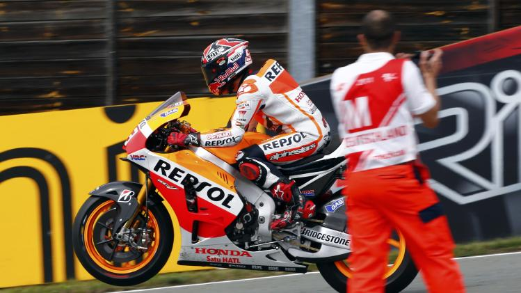 Winner Honda MotoGP rider Marquez of Spain celebrates after the German Grand Prix at the Sachsenring circuit in the eastern German town of Hohenstein-Ernstthal