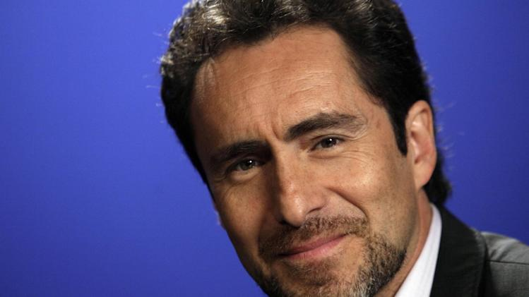 "FILE - In this June 23, 2011 file photo, Mexican actor Demian Bichir poses for photos before an interview, in New York. Bichir stars as Det. Marco Ruiz in the new FX drama, ""The Bridge,"" opposite Diane Kruger, who plays his detective counterpart in the U.S. The TV series premieres July 10 at 10 p.m. Eastern on FX. (AP Photo/Richard Drew, File)"
